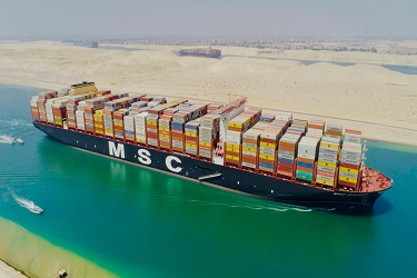 The world's largest container vessel transits the Suez Canal for the
